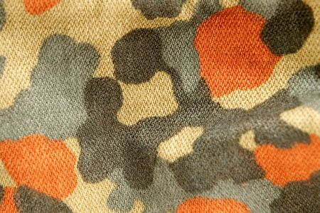 conceal: the fabric military camouflage background