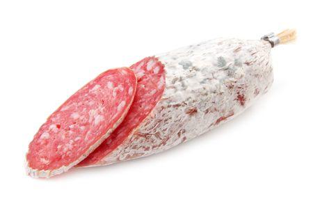 salami slice isolated on white photo