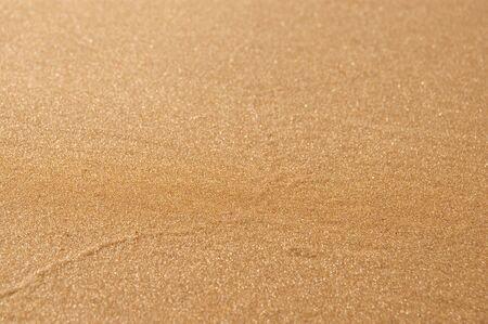 gold sand background close up photo