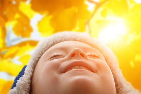 warmly: happiness child smiling to sun