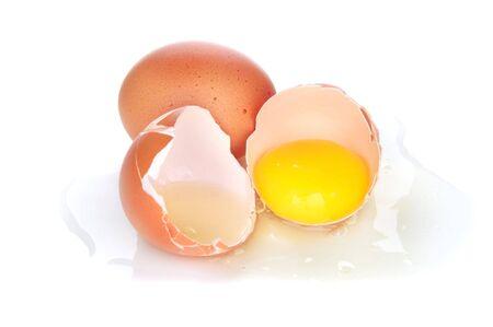 broken egg on white background photo