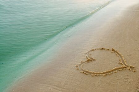 the heart on beach sand  Stock Photo