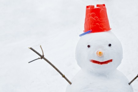 snowman with red cap close up photo