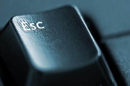 key escape with arrow closeup photo