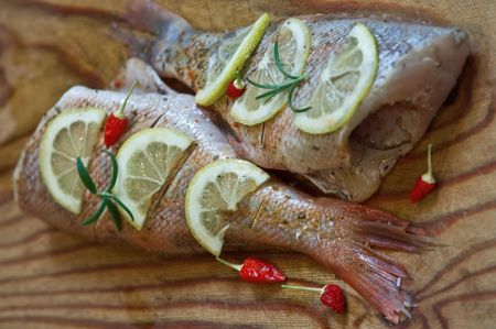 raw bass with lemon and chili pepper Stock Photo - 4648939