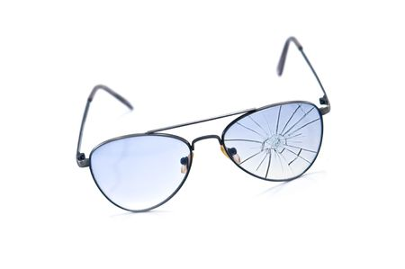 cracked glass: broken blue antisun glasses isolated