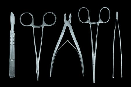 tweezers: medical instruments isolated on black Stock Photo