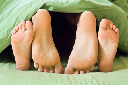 couple foot in bed closeup Stock Photo - 5538416
