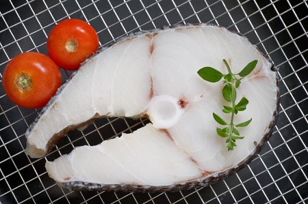 fish steak with oregano twig  photo