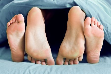 couple foot in bed closeup  Stock Photo - 5585980