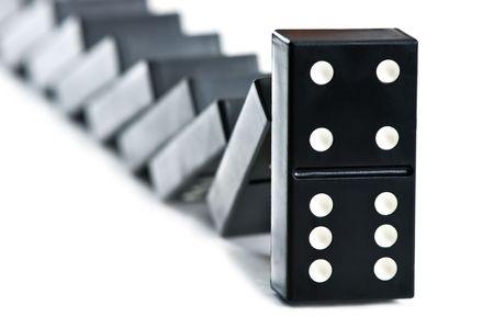 topple: falling domino brick close up