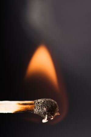 wood match with fire and smoke  photo