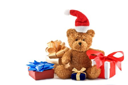teddy bear with presents isolated photo