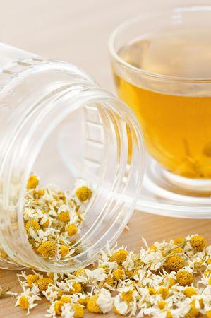 tea from dried camomile closeup photo