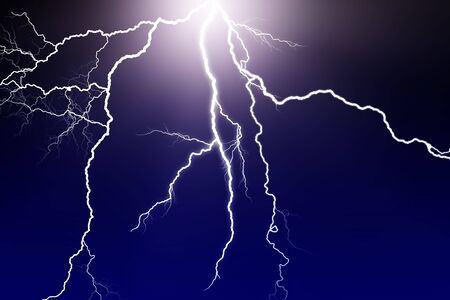 lightning flash in dark sky photo