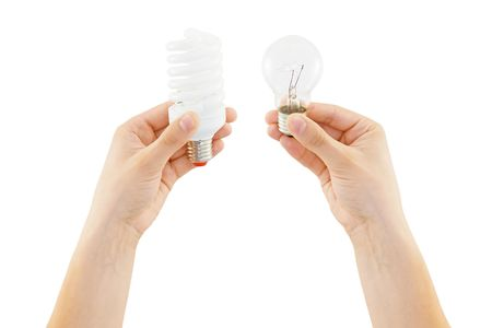 save and incandescent bulb in human hand photo