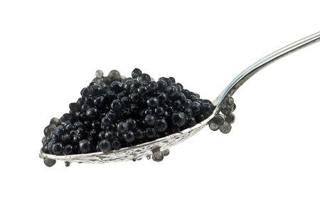 sturgeon: black caviar on spoon isolated