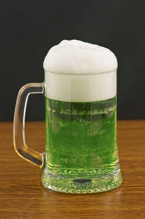 Mug of green beer on wooden counter Stock Photo - 6007622