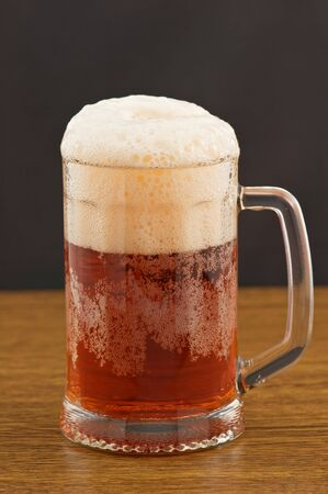 Mug of amber beer on wooden counter Stock Photo - 6007601