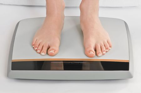 women legs on electronic scales photo