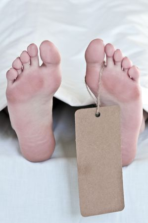 autopsy: dead body feets with label