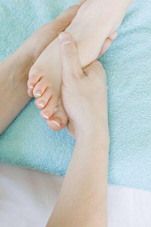 foot massage in spa salon photo