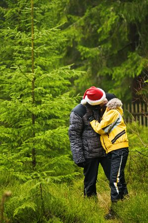 evergreen forest: couple kissing in evergreen forest