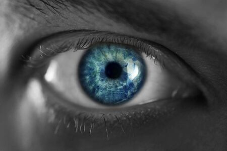 Mans blue eye close up photo