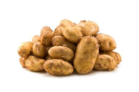 heap of potato isolated on white photo