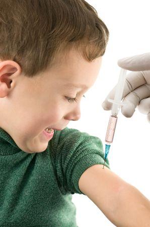 child injecting isolated on white photo