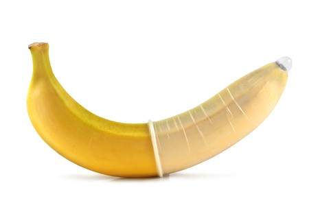 banana with condom isolated on white Stock Photo