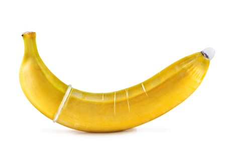 banana with condom isolated on white photo