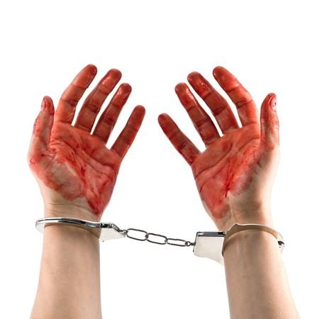 jailbird: bloody murderer hands isolated on white Stock Photo