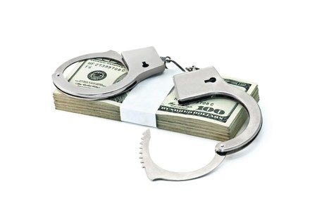 bribing: handcuffs and dollars isolated on white Stock Photo
