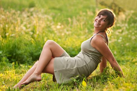 barefoot smiling girl lying in grass Stock Photo - 7760440