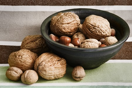 different nuts in black bowl photo