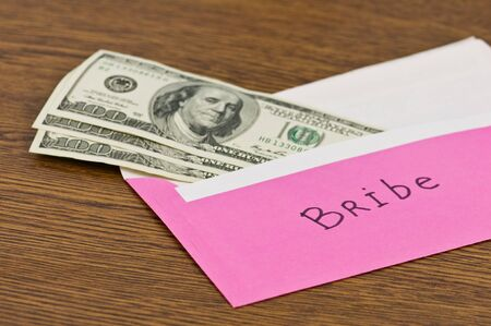 pink envelope with money on wood table photo