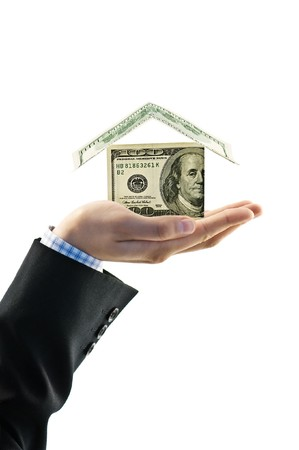 house from dollar in hand isolated photo