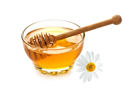 honey in glass jar isolated