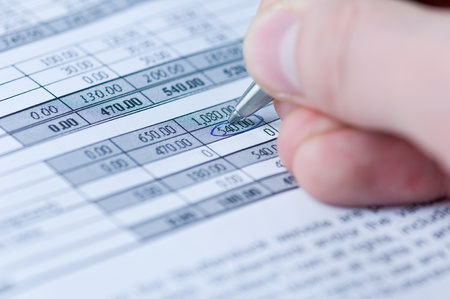financials: pen and financial document closeup Stock Photo