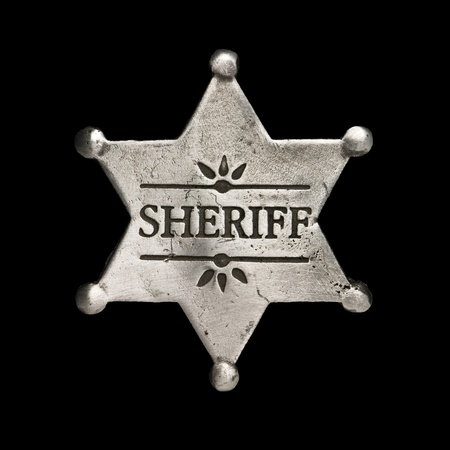 sheriff star isolated on black Stock Photo - 8863537