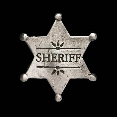sheriff badge: sheriff star isolated on black