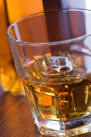 whiskey glass and bottle on wooden counter Stock Photo - 8863557
