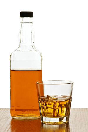whiskey bottle with glass isolated Stock Photo - 8863541