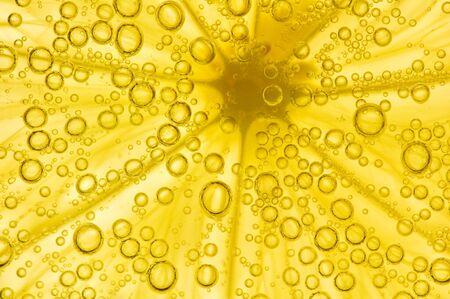 lemon with bubbles isolated on white photo