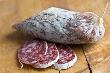 salami pieces on wood table photo