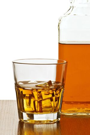 whiskey bottle with glass isolated Stock Photo - 8864171