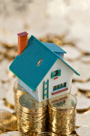 house on gold coins closeup Stock Photo - 9198490