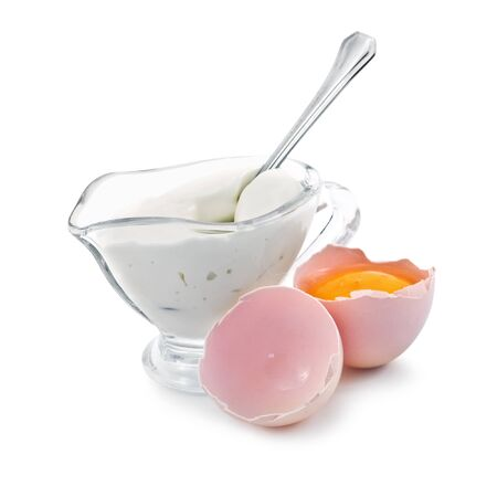 mayonnaise in bowl with broken egg photo