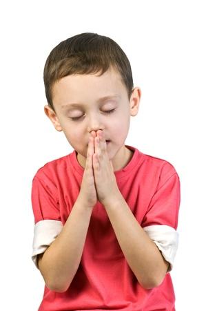 boy praying isolated on white Standard-Bild